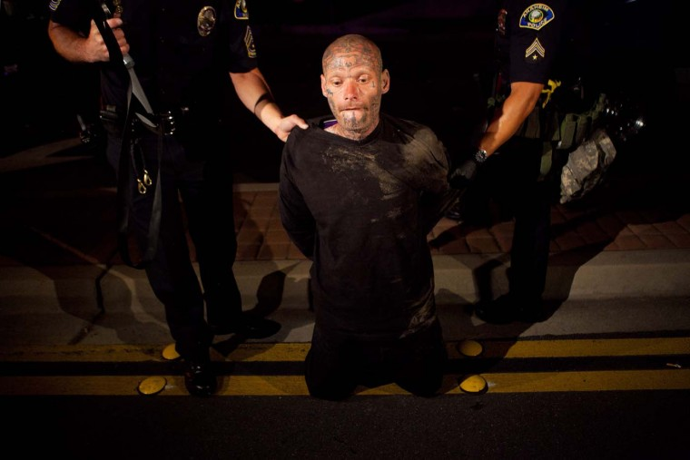 Police officers take a man into custody after he refused to disburse during a demonstration to show outrage for the fatal shooting of Manuel Angel Diaz, 25, at Anaheim City Hall on July 24, 2012 in California. Diaz was fatally shot on July 21 by an Anaheim police officer and has sparked days of protests by the angered community. (Jonathan Gibby/Getty Images)