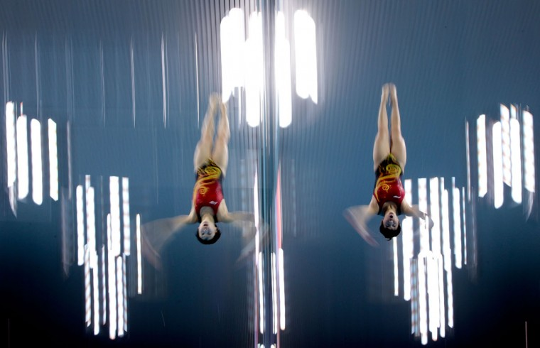 Divers Ruoling Chen and Hao Wang of People's Republic of China practice synchronized diving during a training session ahead of the London Olympic Games at the Aquatics Centre in Olympic Park on July 25, 2012 in London, England. (Adam Pretty/Getty Images)