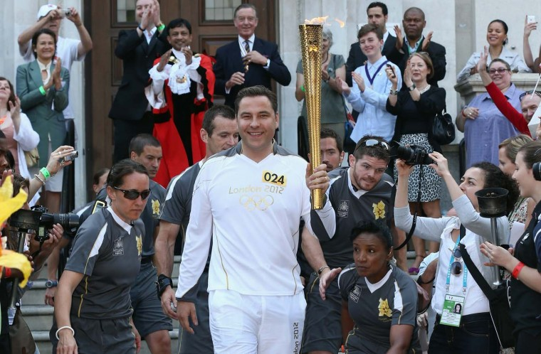 LONDON, ENGLAND - JULY 26: Comedian David Walliams sets off with the Olympic Torch from Islington Town Hall on day 69 of the London 2012 Olympic Torch Relay on July 26, 2012 in London, England. (Dan Kitwood/Getty Images)