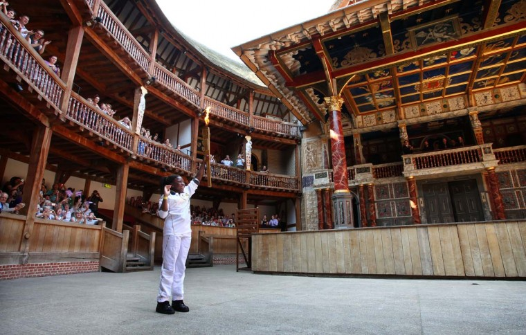 LONDON, UNITED KINGDOM - JULY 26: Torchbearer 048 Ifeyinwa Egesi holds the Olympic Flame inside the Globe Theatre during Day 69 of the London 2012 Olympic Torch Relay on July 26, 2012 in London, England. (LOCOG/Getty Images)