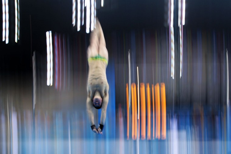 A diver in action during a training session ahead of the London Olympic Games at the Aquatics Centre in Olympic Park on July 26, 2012 in London, England. (Adam Pretty/Getty Images)
