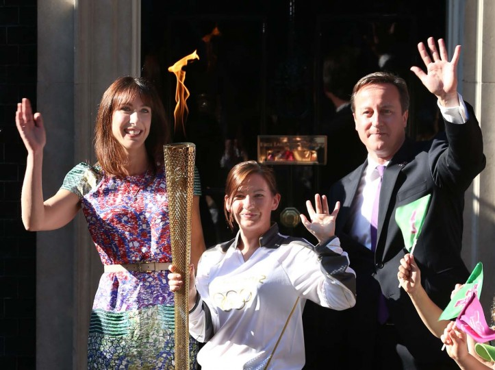 LONDON, ENGLAND - JULY 26: Olympic torch bearer Kate Nesbitt (C) stands with Prime Minister David Cameron and his wife Samantha Cameron in Downing Street on July 26, 2012 in London, England. (Peter Macdiarmid/Getty Images)