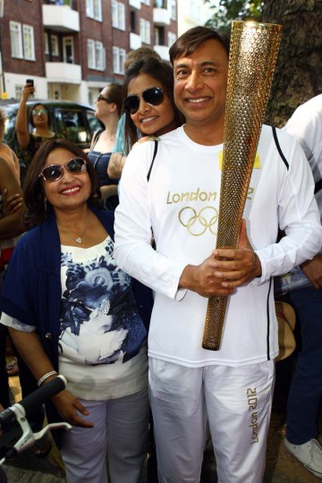 LONDON, UNITED KINGDOM - JULY 26: Lakshmi Mittal with The Olympic Torch On Day 69 Of The Olympic Torch Relay on July 26, 2012 in London, England. (Neil Mockford/Getty Images)