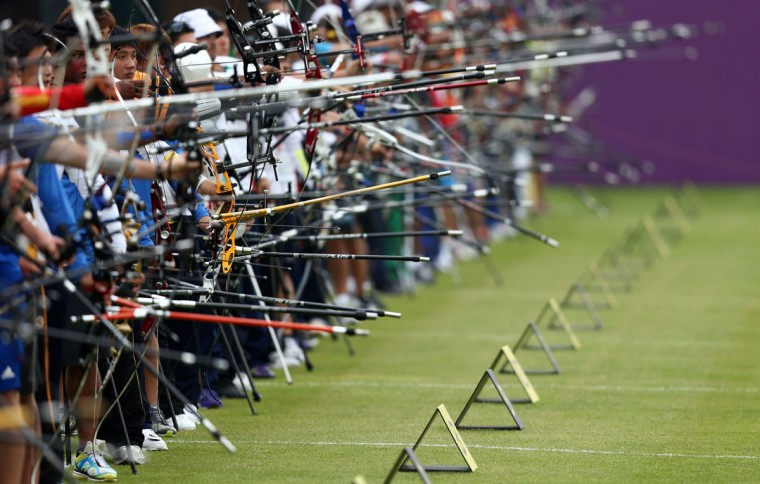 Competitors take aim during the Archery Ranking Round on Olympics Opening Day as part of the London 2012 Olympic Games at the Lord's Cricket Ground on July 27, 2012 in London, England. (Paul Gilham/Getty Images)