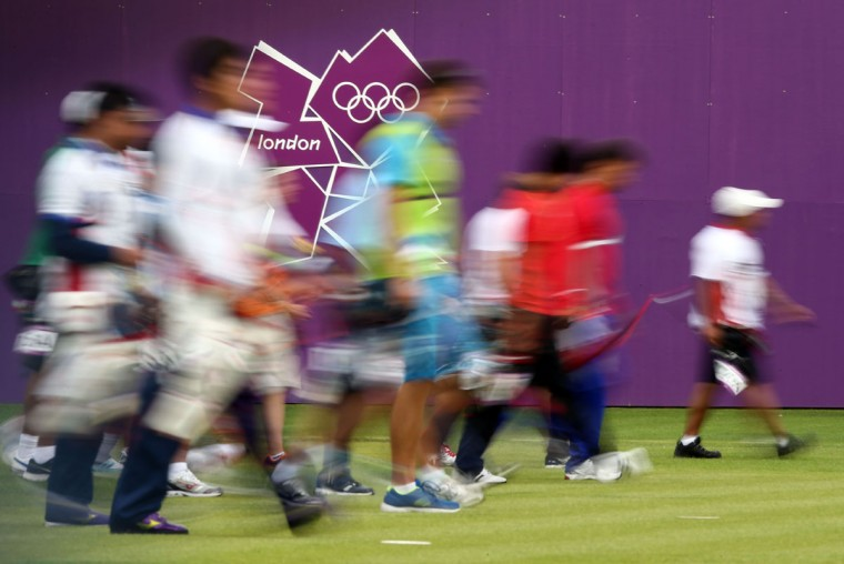 Competitors walk to the targets during the Archery Ranking Round on Olympics Opening Day as part of the London 2012 Olympic Games at the Lord's Cricket Ground on July 27, 2012 in London, England. (Paul Gilham/Getty Images)