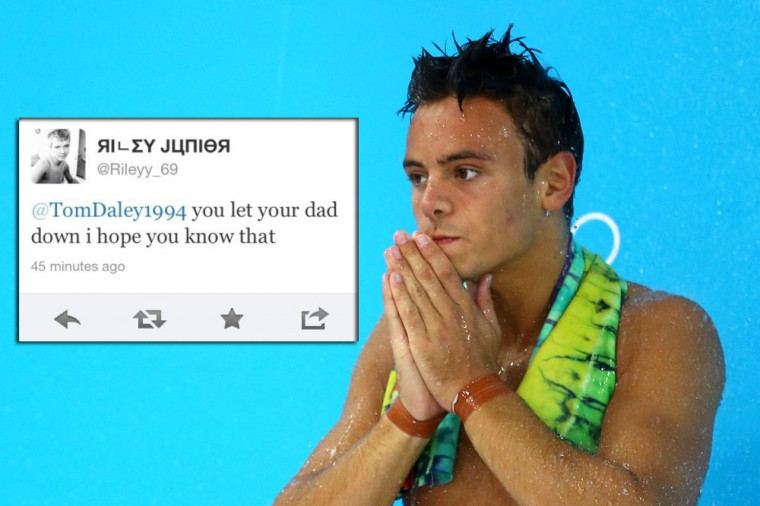"Tom Daley: The athletes aren't the only ones getting in trouble on Twitter. British police arrested a man on Tuesday after offensive tweets were sent to British diver Tom Daley when he failed to win a medal in his first event at the London Olympics. Daley, whose father Robert died from cancer last year, repeated a tweet from user @Rileyy_69 to his followers that said: ""you let your dad down I hope you know that"". The diver responded: ""After giving it my all ... you get idiot's sending me this."" It's illegal in Britain to send ""malicious communications."" (Al Bello/Getty Images)"