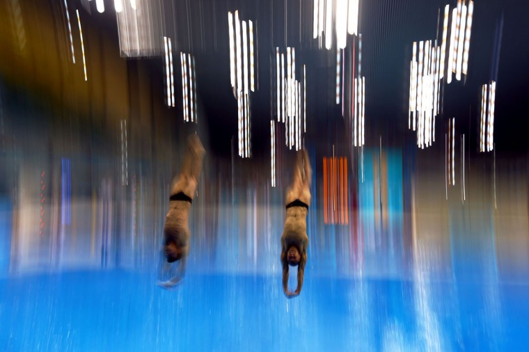 Divers Jeinkler Aguirre and Jose Antonio Guerra of Cuba dive during a training session ahead of the London 2012 Olympic Games at the Aquatics Centre in Olympic Park on July 27, 2012 in London, England. (Al Bello/Getty Images)