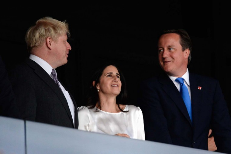 British Prime Minister David Cameron (R), London Mayor Boris Johnson (L) and his wife Marina Johnson (C) enjoy the atmosphere ahead of the Opening Ceremony of the London 2012 Olympic Games at the Olympic Stadium on July 27, 2012 in London, England. (Pascal Le Segretain/Getty Images)