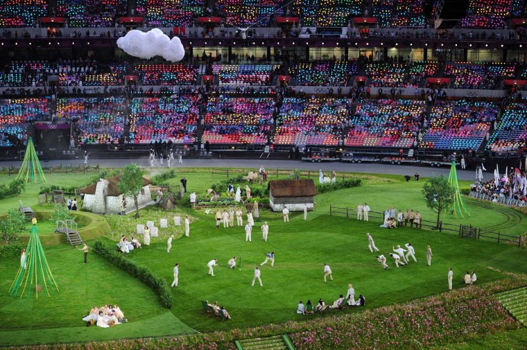 Cricketers play cricket on the pitch during the preshow prior to the Opening Ceremony of the London 2012 Olympic Games at the Olympic Stadium on July 27, 2012 in London, England. (Stu Forster/Getty Images)