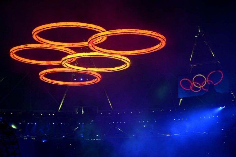 The Olympic rings are assembled above the stadium in a scene depicting the Industrial Revolution during the Opening Ceremony of the London 2012 Olympic Games at the Olympic Stadium on July 27, 2012 in London, England. (Lars Baron/Getty Images)