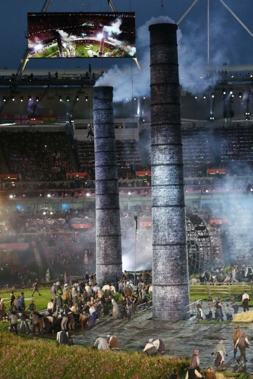Performers depict the industrial revolution during the Opening Ceremony of the London 2012 Olympic Games at the Olympic Stadium on July 27, 2012 in London, England. (Alex Livesey/Getty Images)