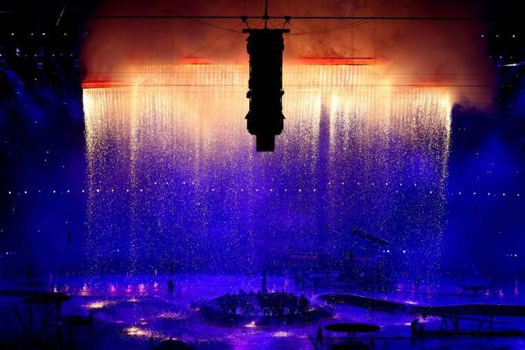 The Olympic rings are assembled above the stadium in a scene depicting the Industrial Revolution during the Opening Ceremony of the London 2012 Olympic Games at the Olympic Stadium on July 27, 2012 in London, England. (Paul Gilham/Getty Images)