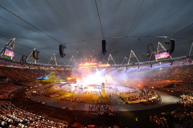 The five Olympic rings rise above a scene depicting the era of the Industrial Revolution during the Opening Ceremony of the London 2012 Olympic Games at the Olympic Stadium on July 27, 2012 in London, England. (Michael Regan/Getty Images)