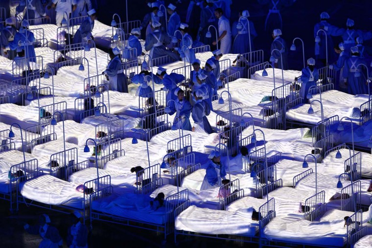Dancers perform as they display the initials GOSH - Great Ormond Street Hospital during the Opening Ceremony of the London 2012 Olympic Games at the Olympic Stadium on July 27, 2012 in London, England. (Paul Gilham/Getty Images)
