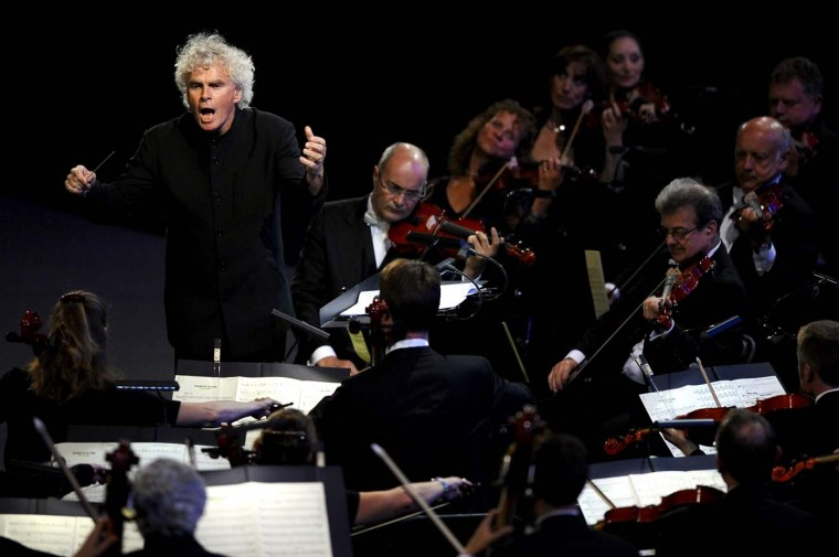 Sir Simon Rattle conducts the London Symphony Orchestra during the Opening Ceremony of the London 2012 Olympic Games at the Olympic Stadium on July 27, 2012 in London, England. (Laurence Griffiths/Getty Images)