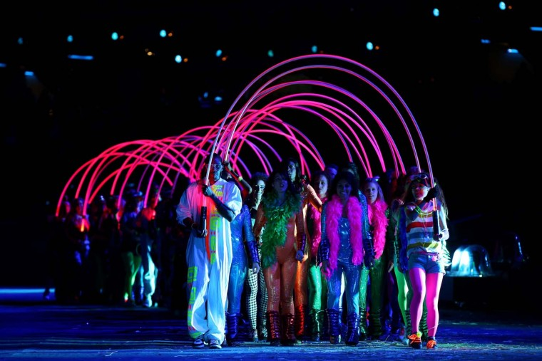 Performers represent a British teenager through the years during the Opening Ceremony of the London 2012 Olympic Games at the Olympic Stadium on July 27, 2012 in London, England. (Cameron Spencer/Getty Images)