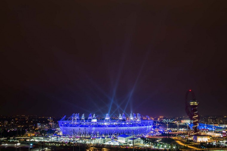 The Olympic Stadium is illuminated during the opening ceremony of the 2012 London Olympic Games on July 27, 2012 in London, England. Athletes, heads of state and dignitaries from around the world have gathered in the Olympic Stadium for the opening ceremony of the 30th Olympiad. London plays host to the 2012 Olympic Games which will see 26 sports contested by 10,500 athletes over 17 days of competition. (Daniel Berehulak/Getty Images)