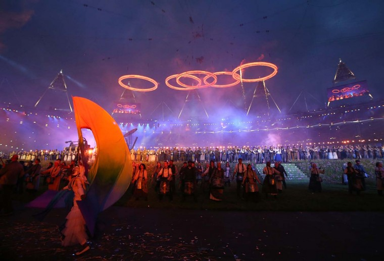 Rings representing both the Olympics and the Industrial Revolution are lit and lifted during the Opening Ceremony of the London 2012 Olympic Games at the Olympic Stadium on July 27, 2012 in London, England. (Cameron Spencer/Getty Images)