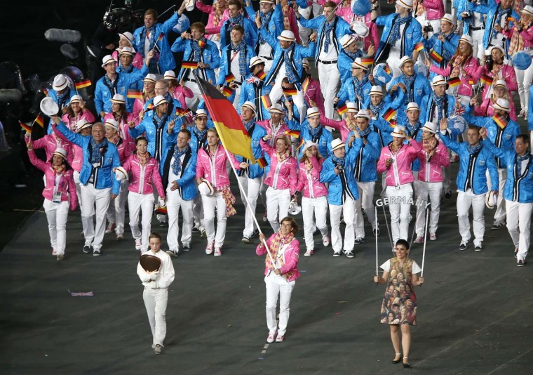 Natascha Keller of the Germany Olympic hockey team carries her country's flag during the Opening Ceremony of the London 2012 Olympic Games at the Olympic Stadium on July 27, 2012 in London, England. (Quinn Rooney/Getty Images)