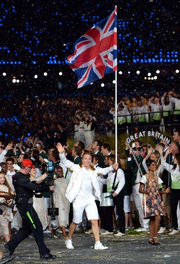 Sir Chris Hoy of the Great Britain Olympic cycling team carries his country's flag during the Opening Ceremony of the London 2012 Olympic Games at the Olympic Stadium on July 27, 2012 in London, England. (Lars Baron/Getty Images)