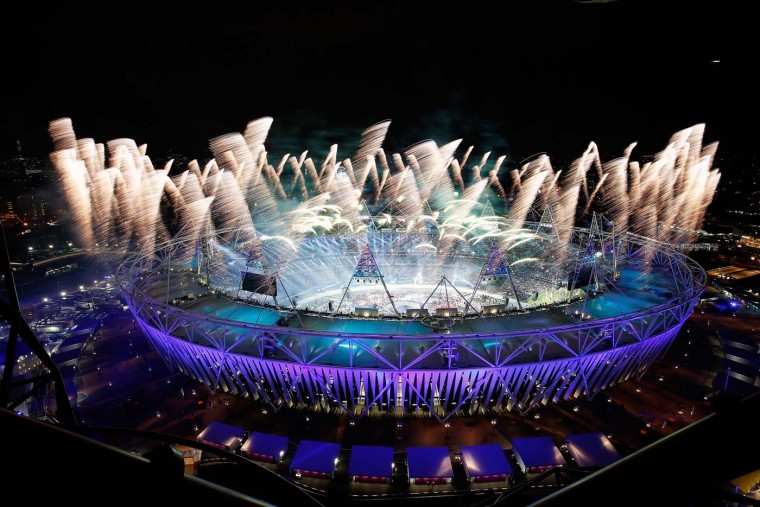 Fireworks ignite over the Olympic Stadium during the Opening Ceremony for the 2012 Olympic Games on July 27, 2012 at Olympic Park in London, England. (Jamie Squire/Getty Images)