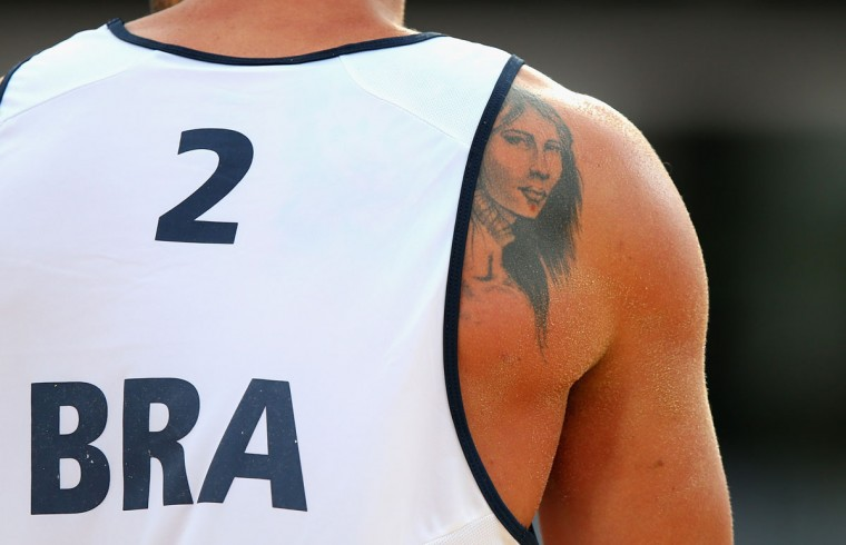 The tattoo of Pedro Cunha of Brazil is seen during the Men's Beach Volleyball Preliminary match between Brazil and Great Britain on Day 3 of the London 2012 Olympic Games at Horse Guards Parade on July 30, 2012 in London, England. (Ryan Pierse/Getty Images)
