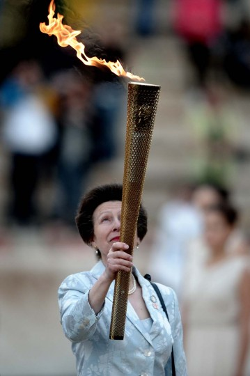 MAY 17: Princess Anne of Britain holds the torch with the Olympic Flame during the handover ceremony of the Olympic flame for the 2012 London Olympics at the Panathenaic stadium in Athens. (Aris Messinis/AFP/Getty Images)