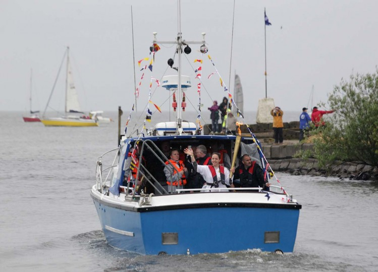 JUNE 7: Olympic Torchbearer Eorann O'Neill, 16, carries the torch in a boat across Northern Ireland's largest fresh water lake Lough Neagh from Antrim in Northern Ireland. (Peter Muhly/AFP/Getty Images)