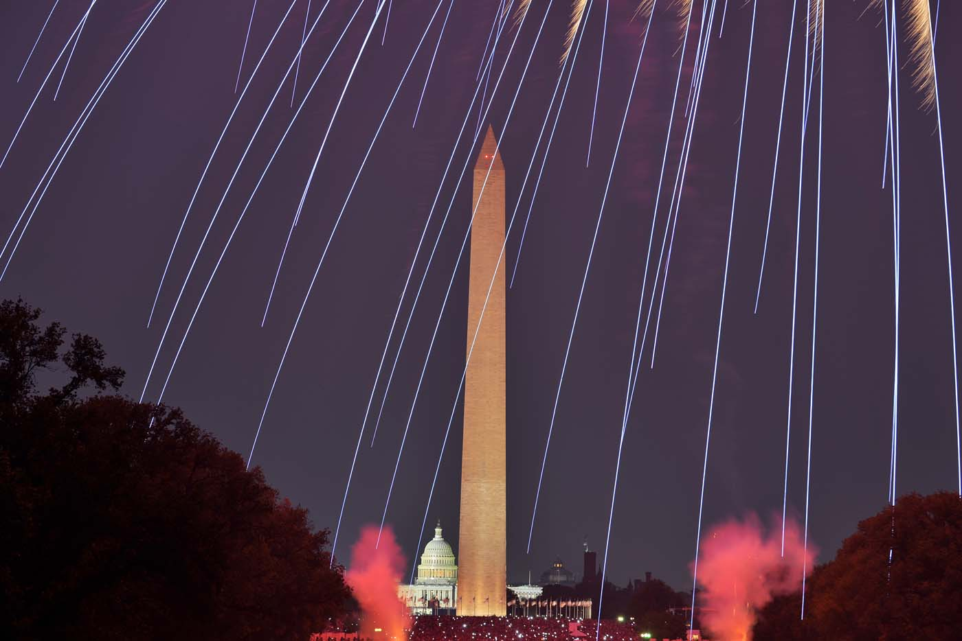 Fireworks illuminate the night sky over the Washington Monument and the Capitol Dome (bottom) during Fourth of July celebrations in Washington, (Jewel Samad/AFP/Getty Images)