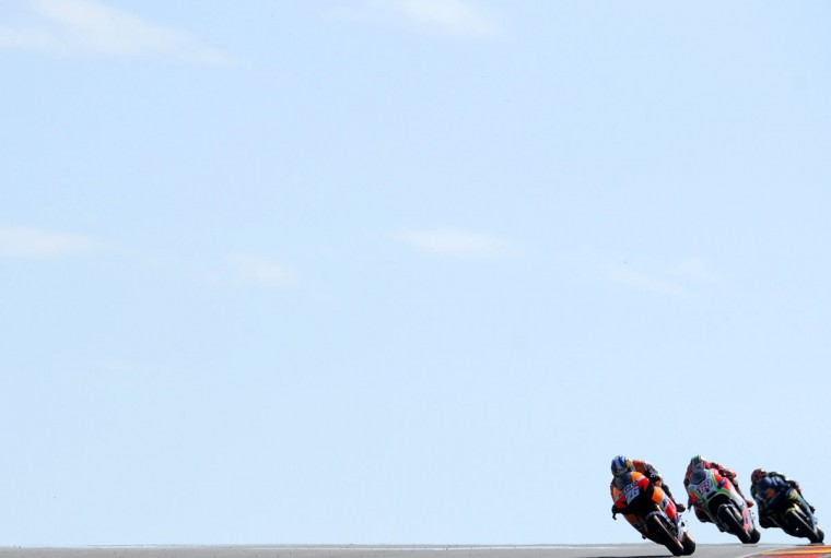 (L -R) Spain's Dani Pedrosa of Repsol Honda Team, US Nicky Hayden of Ducati Team and Italy's Andrea Dovizioso of the Repsol Honda team compete during the first training session of the MotoGP of the Grand Prix of Germany at the Sachsenring Circuit in Hohenstein-Ernstthal, eastern Germany. (Robert Michael/AFP/Getty Images)