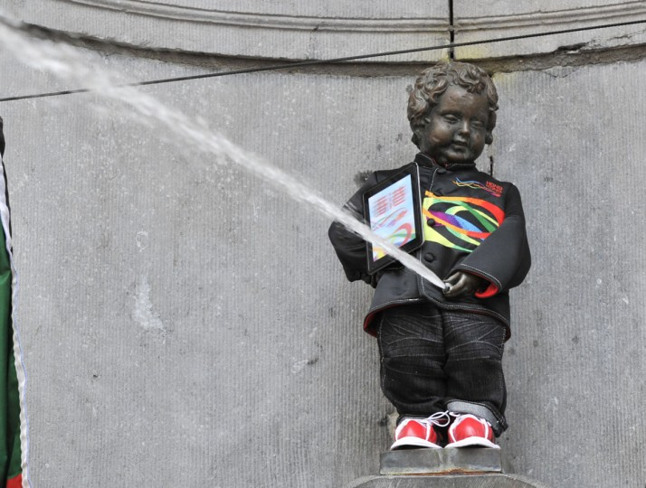 The Manneken-Pis fountain in Brussels sports a traditional Hong Kong costume. It is the first time the bronze boy that pees into a fountain wears such a costume, including a traditional Zhongshan suit and a clipboard under his arm. (Georges Gobet/AFP/Getty Images)