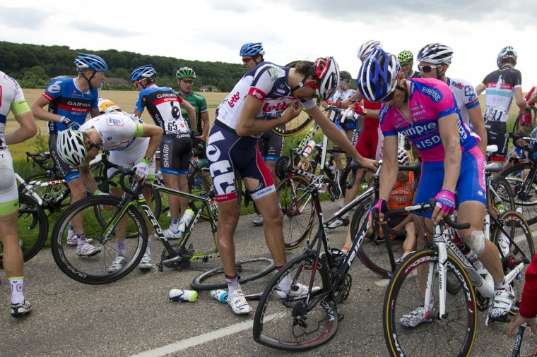 A general view shows riders and their crashed wheels after the crash of around 30 riders 26 km before the end of the 207,5 km and sixth stage of the 2012 Tour de France cycling race starting in Epernay and finishing in Metz, northeastern France. (Joel Saget/AFP/Getty Images)