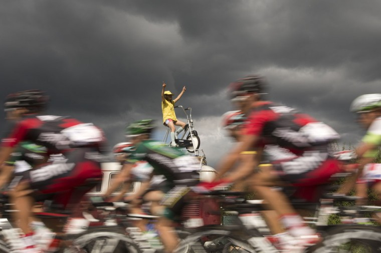 A fan, wearing a yellow jersey of overall leader, cheers on the pack riding in the 207,5 km and sixth stage of the 2012 Tour de France cycling race starting in Epernay and finishing in Metz, northeastern France. (Joel Saget/AFP/Getty Images)