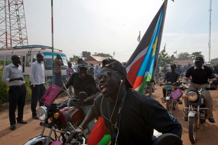 South Sudanese celebrate on the street on the eve of of the country's first anniversary marking its independence from Sudan in Juba on July 8, 2012. (Giulio PetroccoGiulio Petrocco/AFP/Getty Images)