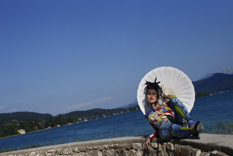 A participant poses with her body paintings in front of the Woerthersee lake during the 15th World Bodypainting Festival in Poertschach on July 8, 2012. Some 30,000 visitors are expected at the three-day event, with over 200 artists from 44 countries. (Alexander Klein/AFP/Getty Images)