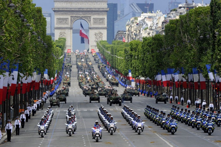 Motorcyclist squadron of French National gendarmerie take part in the annual Bastille Day military parade on the Champs-Elysees in Paris July 14, 2012. The Arc de Triomphe is seen in the background. (Bertrand Guay/AFP/Getty Images)
