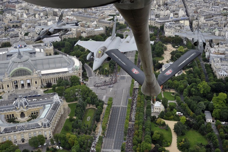 Picture taken from a Boeing C135, refueling tanker, shows of two French Rafale (C) fighters and two Mirage fighters, as they fly over Paris during the annual Bastille Day military parade on the Champs-Elysees in Paris July 14, 2012. is seen in the background. (Boris Horvat/AFP/Getty Images)