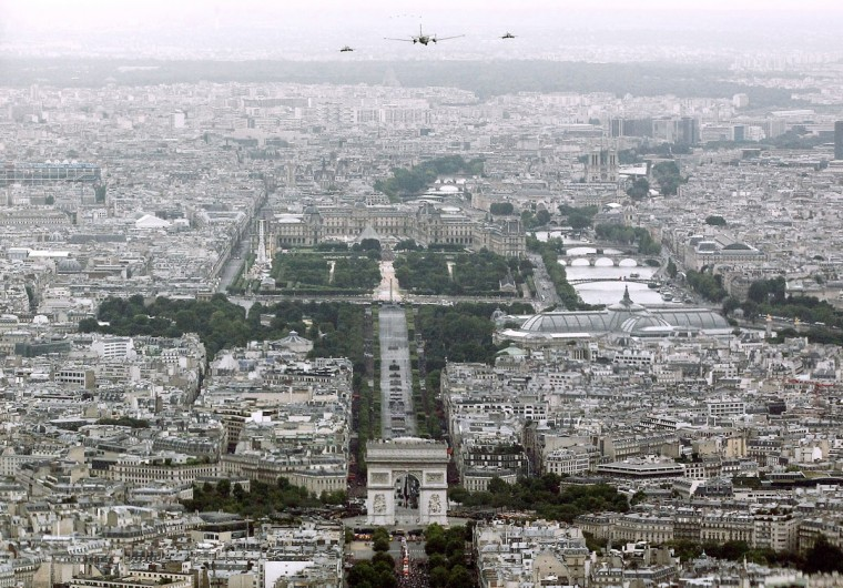 French military aircraft fly over Paris during the Bastille Day military parade in Paris, on July 14, 2012. (Guillaume Baptiste/AFP/Getty Images)