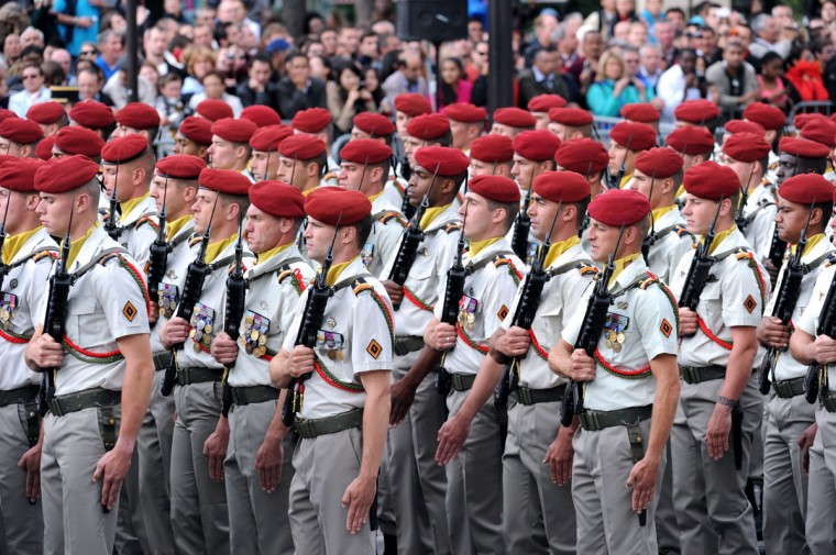 French paratroopers from the 1st Parachute Chasseur Regiment take part in the annual Bastille Day military parade on the Champs-Elysees in Paris July 14, 2012. The Arc de Triomphe is seen in the background. (Mehdi Fedouach/AFP/Getty Images)