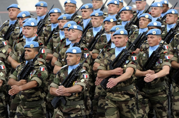 Peacekeepers from the United Nations Interim Force in Lebanon (UNIFIL) (In French : FINUL) take part in the annual Bastille Day military parade on the Champs-Elysees in Paris July 14, 2012. (Bertrand Guay/AFP/Getty Images)