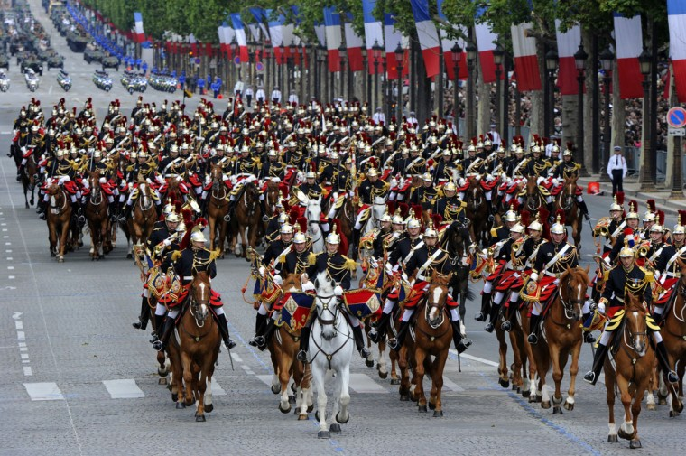 Mounted French Republican guards take part in the annual Bastille Day military parade on the Champs-Elysees in Paris, on July 14, 2012. (Bertrand Guay/AFP/Getty Images)
