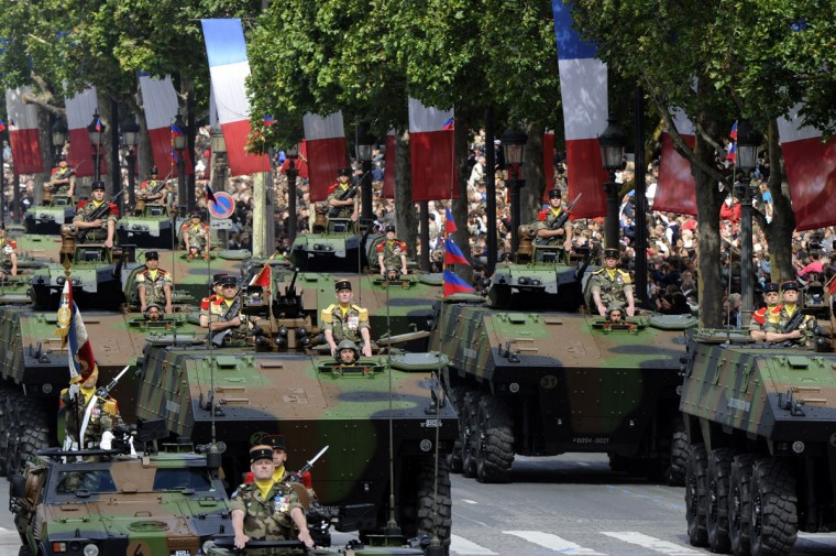 French Infantry fighting vehicles (VBCI) from the 92nd Infantry Regiment parade on the Champs-Elysees avenue during the annual Bastille Day military parade in Paris, on July 14, 2012. (Bertrand Guay/AFP/Getty Images)