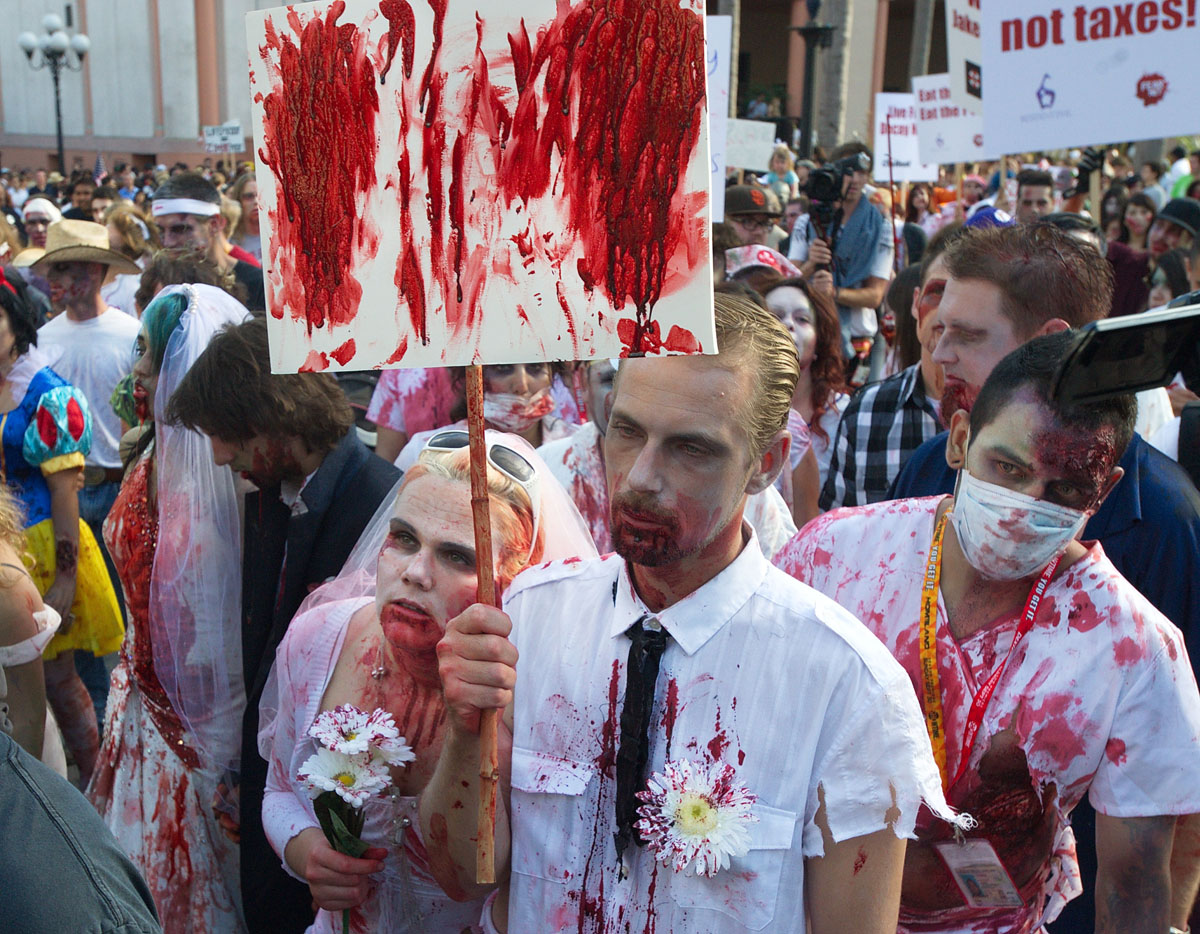 July 14 Photo Brief: Zombies in the streets, Obama in the rain, rock-n-roll in the sea