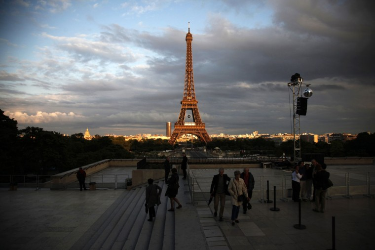 People arrive on the Esplanade des Droits de l'homme (Human Rights) at the Trocadero, before the start of a fireworks show on the Eiffel Tower, as part of the Bastille Day celebrations on July 14, 2012 in Paris. (Guillaume Baptiste/AFP/Getty Images)