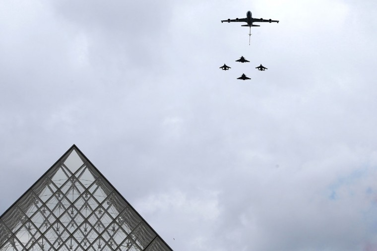 A French Boeing C135, refueling tanker (top) and fighter jets fly over the Louvre museum during the Bastille Day military parade in Paris, on July 14, 2012. (Kenzo Tribouillard/AFP/Getty Images)