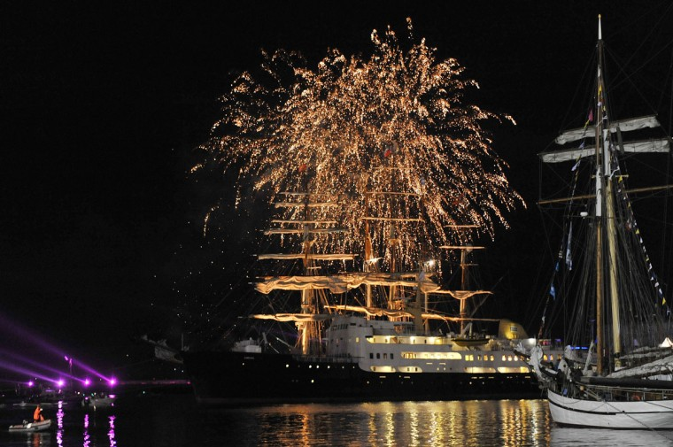 """Fireworks illuminate the night sky above traditional boats gather in the Brest bay as part of the shipping festive event """"Tonnerres de Brest"""", during the annual Bastille Day celebrations on July 14, 2012 in Brest, western France. (Alain Jocard/AFP/Getty Images)"""