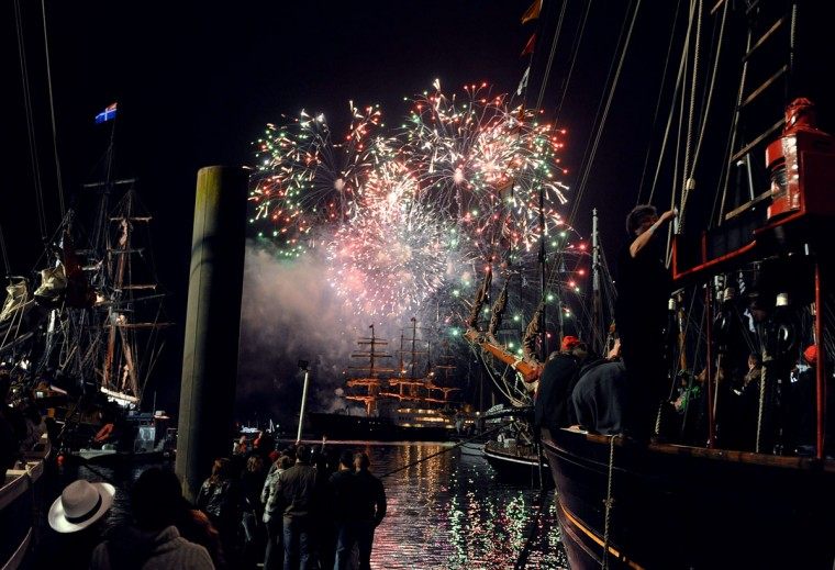 "Fireworks illuminate the night sky above traditional boats gather in the Brest bay as part of the shipping festive event ""Tonnerres de Brest"", during the annual Bastille Day celebrations on July 14, 2012 in Brest, western France. (Alain Jocard/AFP/Getty Images)"