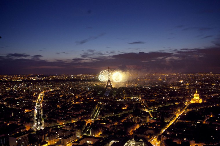A general view taken at night shows Paris and the Eiffel Tower during the firework as part of the annual Bastille Day celebrations on July 14, 2012 in Paris. (Loic Venance/AFP/Getty Images)