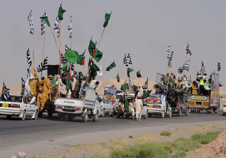 Pakistani Islamists travel towards Chaman in Killa Abdullah district in the north west of Balochistan province. About 5,000 Pakistani Islamists who oppose the anti-terrorism alliance with Washington began a march to the border in protest over the reopening of NATO supply routes into Afghanistan. (Banaras Khan/AFP/GettyI mages)