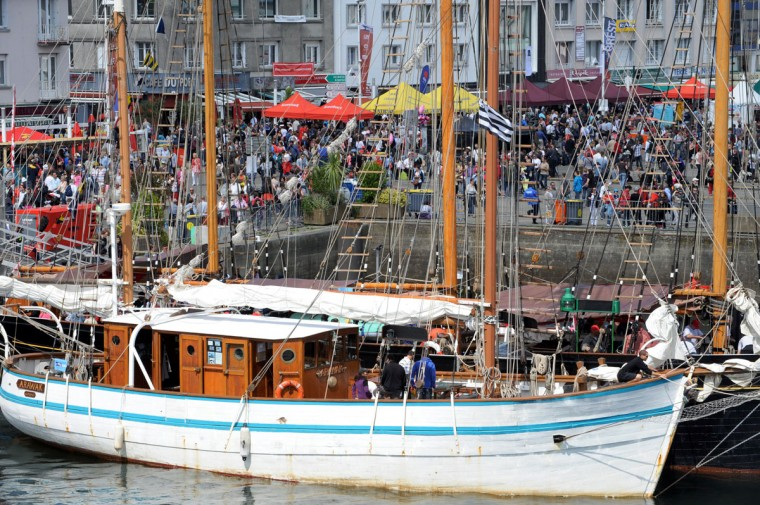 "Spectators watch sailboats at the ""Tonnerres de Brest"" maritime festival in Brest, France July 15, 2012. (Fred Tanneau/AFP/Getty Images)"